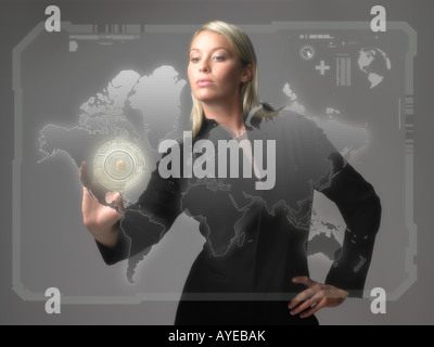 Woman with world on screen - Stock Photo