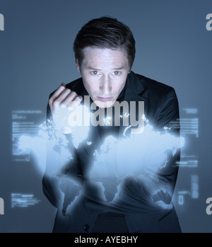 Man and world on screen - Stock Photo