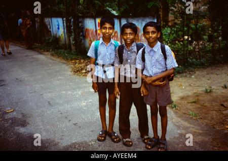 Near Philipkutty's Farm Pallivathukal Kerala India Boys on their Way to School - Stock Photo