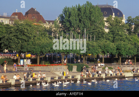 People at the Uto Quai quay close to Zurichsee lake in Zurich Switzerland - Stock Photo