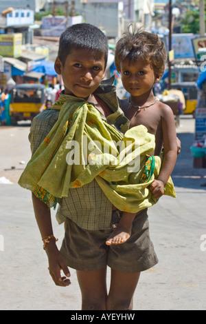 Young Indian Boys Begging in Kanyakumari South India - Stock Photo