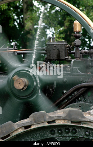 Detail of traction engine under steam with flywheel rotating - Stock Photo
