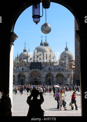 Tourists take pictures of Basillica di San Marco in St Marks Square - Stock Photo