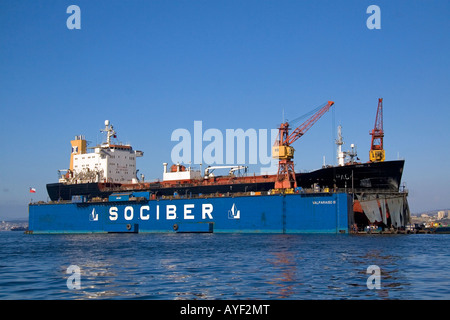 Floating dry dock with container ship in the Port at Valparaiso Chile - Stock Photo