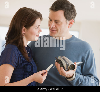 Couple shopping for video cameras - Stock Photo