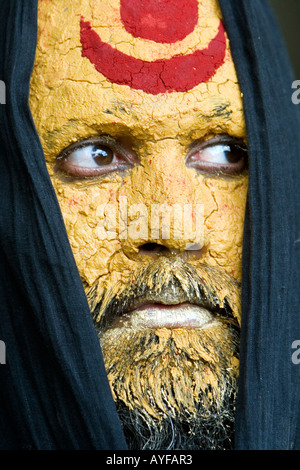 Indian sadhu with his face covered in sandalwood paste and a shiva mark. India. Portrait - Stock Photo