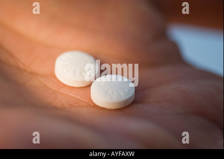 Close up of medication in man's hand - Stock Photo