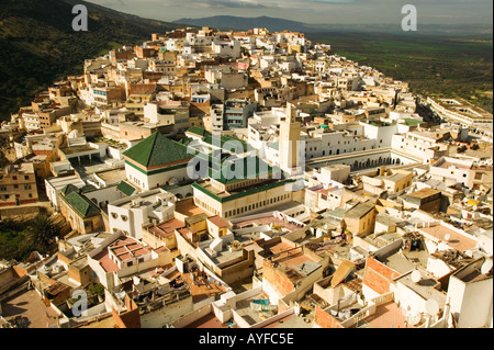 City View of the town of Moulay Idriss one of the countries most important Muslim pilgrimage sites Morocco - Stock Photo