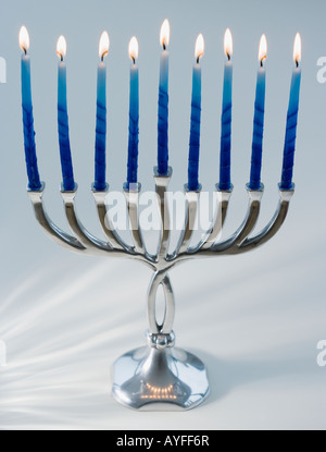 Close up of menorah with lit candles - Stock Photo