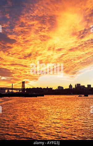 Williamsburg Bridge and sunset, New York City - Stock Photo