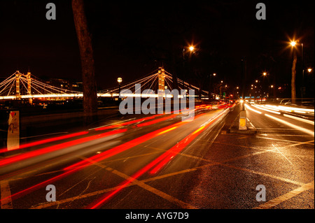 Fast moving nightime rushhour London urban traffic on Londons embankment - Stock Photo