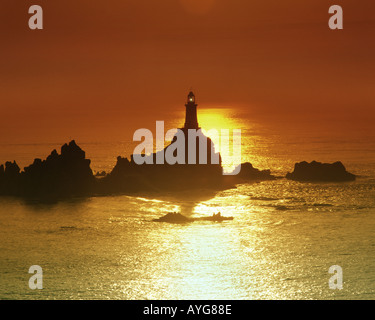 GB - JERSEY: La Corbiere Lighthouse at sunset - Stock Photo