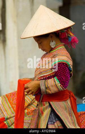 Flower Hmong Women Making Colouful Clothing and Fabrics Bac Ha Market near Sapa Vietnam - Stock Photo