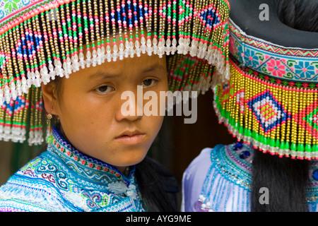 Two Beautiful Young Flower Hmong Women Bac Ha Market near Sapa Vietnam - Stock Photo