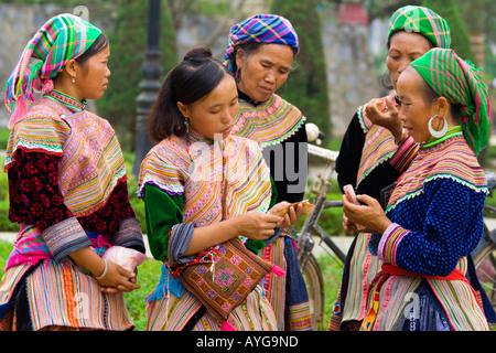 Flower Hmong Women Conducting a Transaction Bac Ha Market near Sapa Vietnam - Stock Photo