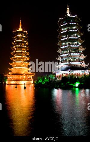 Sun Moon Pagodas Night at Shan Lake Guilin China - Stock Photo