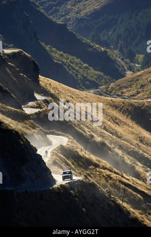 Landrover and Mountain Bike on Infamous Road into Skippers Canyon near Queenstown South Island New Zealand - Stock Photo
