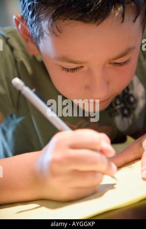 Boy writing - Stock Photo