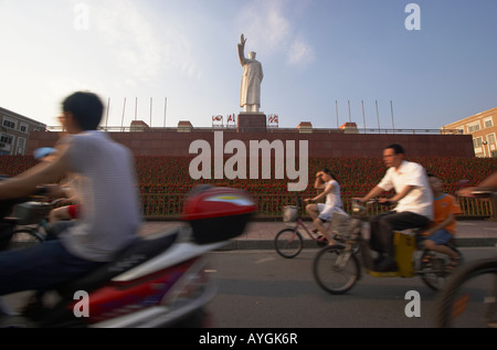 Cyclists Riding Past Mao Zedong Statue In Tianfu Square, Chengdu, China - Stock Photo