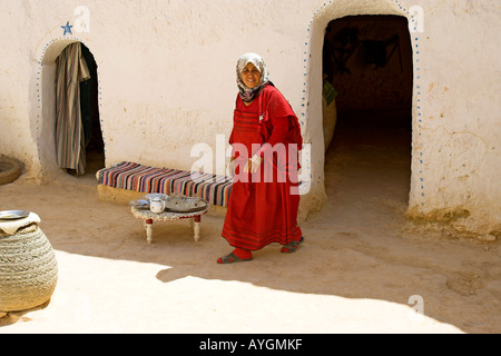 Woman in Berber troglodyte underground home insulated from heat and whitewashed Matmata Tunisia - Stock Photo