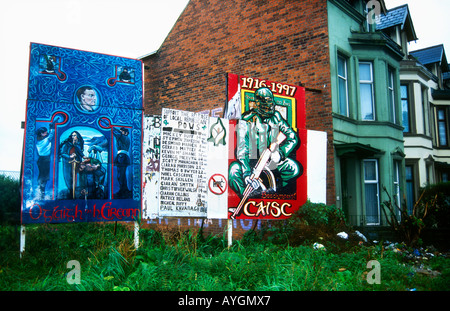 Political street murals in the Catholic area of the Falls Road West Belfast Northern Ireland - Stock Photo