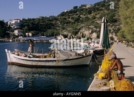 young fishermen in the small harbour of Gaios in Paxos Island Greece - Stock Photo