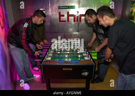 Fiour young men play table football Heineken Experience Amsterdam The Netherlands - Stock Photo