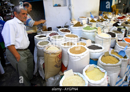 Spices grain and pulses for sale in sacks Sousse Medina Tunisia - Stock Photo
