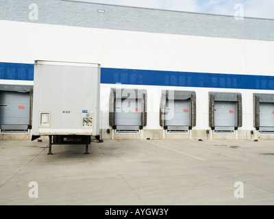 Truck parked at loading dock - Stock Photo