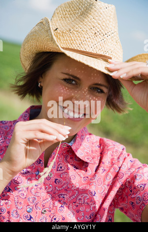 Teenage girl wearing straw hat - Stock Photo