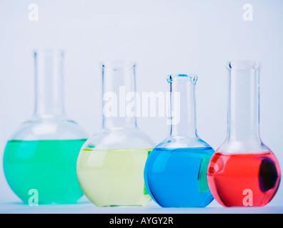 Row of beakers with liquid - Stock Photo