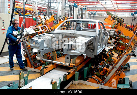 Rolls Royce Bentley production line at the company factory in Crewe, Cheshire. Picture shows welding body panels. - Stock Photo