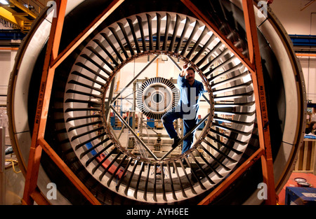 Rolls Royce New Engine Assembly and Testing Line Fitter inspects the Fan Case of a Trent 800 for a Boeing 777 - Stock Photo