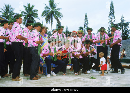 Polynesians playing local native music on Aitutaki in Cook Islands - Stock Photo