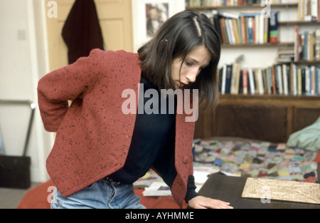 young woman experiencing lower back pain - Stock Photo