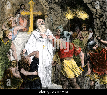 Christians in the Catacombs arrested by Roman soldiers. Hand-colored woodcut - Stock Photo