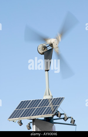 Small Wind Turbines And Solar Panels On The Roof Of The