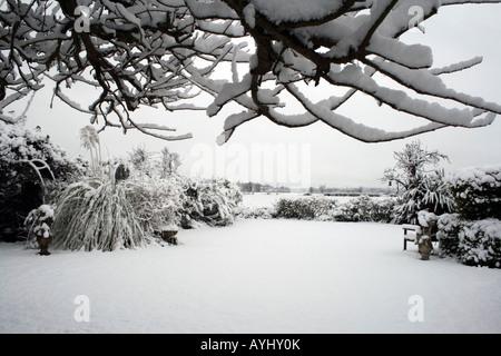 Snow scene in April, an English garden