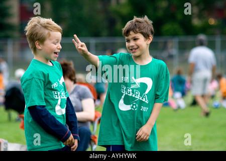 Boys age 7 celebrating on soccer field. Carondelet Field by Expo School St Paul Minnesota USA - Stock Photo