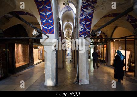 muslim woman shopping in the grand Bazaar Istanbul Turkey - Stock Photo