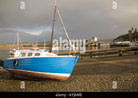 CONWY NORTH WALES UK October A blue motor boat beached at low tide - Stock Photo