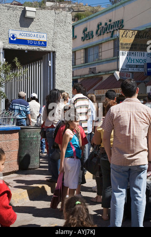 Nogales Sonora Mexico People line up to cross the border from Mexico into the United States - Stock Photo