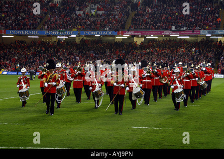 Regimental Band of The Royal Welsh Regiment marching in the Millenium Stadium, Cardiff before the Wales v France - Stock Photo