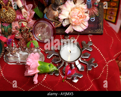 Diwali Decorations Gods Flowers and Candles Tooting London England - Stock Photo