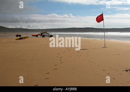 Lifeguards protect the safety of swimmers and surfers at Woolacombe beach in north Devon, South West England on - Stock Photo