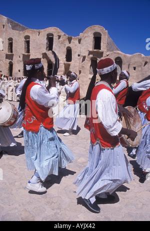Berber musicians celebrating the Ksour Festival at Ksar Ouled Soltane near Tataouine Tunisia - Stock Photo