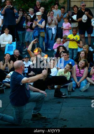 Mighty Gareth swallowing fire, Edinburgh Fringe Festival Scotland - Stock Photo