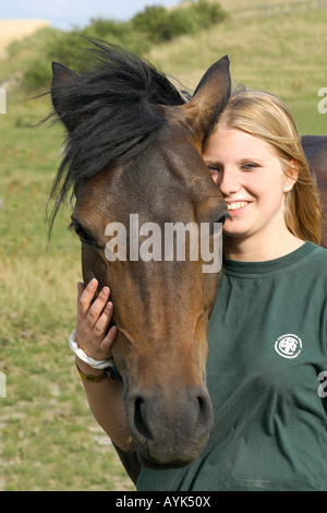 Girl with Connemara pony - portrait - Stock Photo
