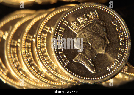 Five one pound coins on edge overlapping close up - Stock Photo