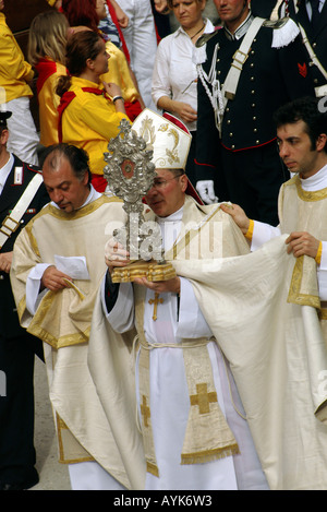 Bishop of Gubbio holding a religious relic in a procession part of the Gubbio Ceri race day on May 15 - Stock Photo